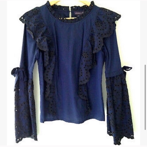 Anthropologie Tops - Amaryllis. Eyelet bell sleeve blouse with bows .